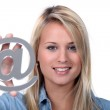 Girl holding @ sign — Stock Photo #7932141