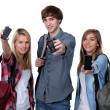 Stock Photo: Three teenage students with backpacks and cellphones