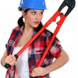 Sultry brunette holding bolt cutter — Stock Photo #7932321