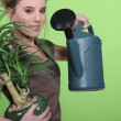 Woman watering plants — 图库照片