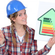 Craftswomholding energy consumption label — Stock Photo #7932547