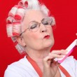 Old woman in rollers — Stock Photo