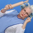 Angry old lady with rolling pin — Stock Photo #7932632