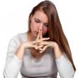 Pensive woman with her hands to her face — Stock Photo