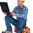 Distraught tradesman reading his emails — Stock Photo