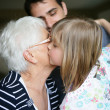 Child kissing her grandma — Stock Photo #7933425