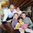 Family gathered around laptop — Stock Photo