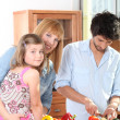 Family in their kitchen - Stock Photo