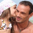 Girl giving dad a kiss — Stock Photo