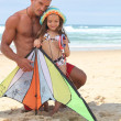 Stock Photo: Father and daughter with kite