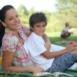 A mother and her son at picnic, the father is fishing — Stock Photo