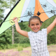Girl flying her kite — Stock Photo
