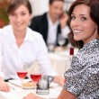 Women eating out in a restaurant together — Stock Photo