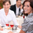 Women eating out in a restaurant together — Stock Photo #7933840