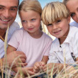Happy family at beach — Stock Photo