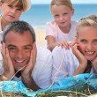 Family at the beach — Foto Stock