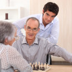 Grandparents playing chess — Stock Photo #7933967