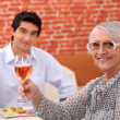 Stock Photo: Grandmother and grandson having meal in restaurant