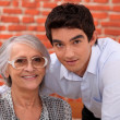 Stock Photo: Grandson and grandmother in restaurant