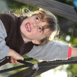 Little girl having fun on climbing frame — Stock Photo