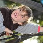 Little girl having fun on climbing frame — Stock Photo #7934185
