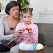 Stock Photo: Mother and daughter knitting