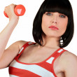 Attractive brunette lifting weights in gym - Stock Photo