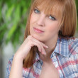 Portrait of a young redhead woman with blue eyes — Stock Photo