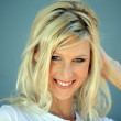 Coy blond woman touching hair — Stock Photo