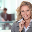 Portrait of mature woman in gray suit — Stock Photo