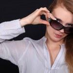 Woman adjusting her sunglasses — Stock Photo #7935077