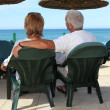 Middle aged couple resting by the beach. — Stock Photo #7935585