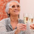Elderly couple toasting in restaurant — Stock Photo #7935697