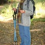 Senior lady on a mountain hike — Stock Photo