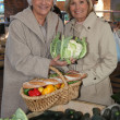 Stock Photo: Senior ladies at market