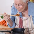 A grandmother cooking. — Stock Photo