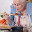 Stock Photo: Grandmother cooking.