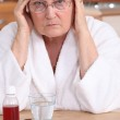 Bitter woman in front of her medication — Stock Photo