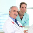 A doctor and a nurse looking at some results — Stock Photo