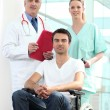 Hospital patient in wheelchair — Stockfoto