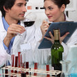 Stock Photo: Oenologists analysing wine