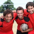 Three football team mates — Stock Photo