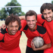 Stock Photo: Three football team mates