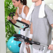 Stock Photo: Couple working out in gym