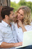 Man and woman in a park — Stock Photo