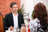 Couple eating out in a restaurant — Stock Photo