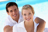 Grinning young couple — Stock Photo