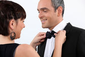 Wife helping husband with bow tie — Stock Photo