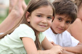 Young children together in a park — Stock Photo