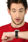 Man in shock looking at his watch — Stock Photo
